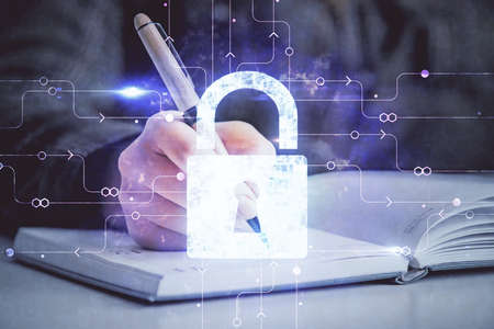 Double exposure of hands making notes with lock icons. Concept security and protection of data Standard-Bild