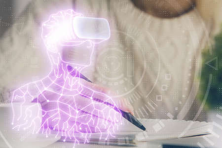 AR hologram over womans hands taking notes background. Concept of augmented reality. Multi exposure