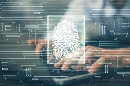 Fingerprint hologram with businessman working on computer on background. Security concept. Double exposure.