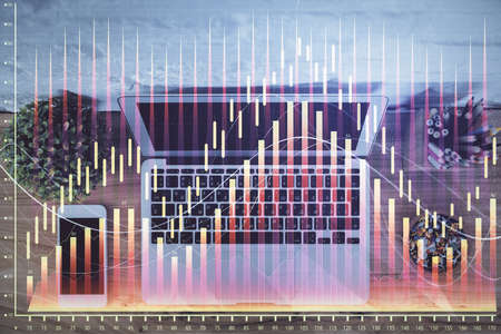 Multi exposure of financial chart drawing over table background with computer. Concept of research and analysis. Top view. 版權商用圖片