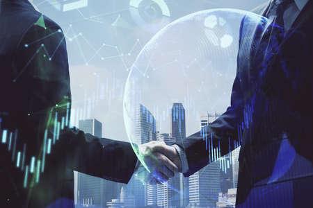 Double exposure of forex graph hologram and handshake of two men. Stock market concept. Standard-Bild