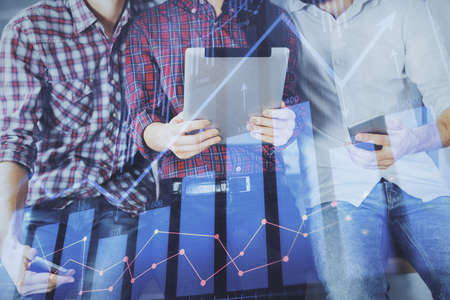Double exposure of forex graph drawing and man and woman working together holding and using a mobile device. Trade concept.