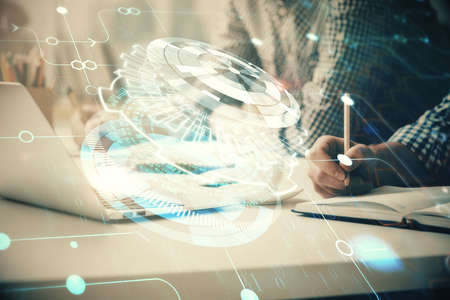Businessman with computer background with technology theme hologram. Concept of hightech. Multi exposure.