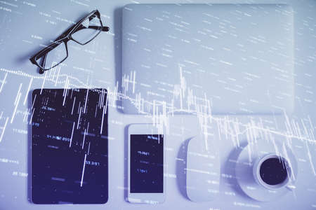 Multi exposure of financial chart hologram over desktop with phone. Top view. Mobile trade platform concept.