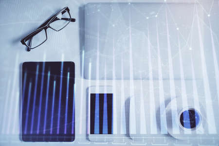 Multi exposure of financial chart hologram over desktop with phone. Top view. Mobile trade platform concept. 版權商用圖片