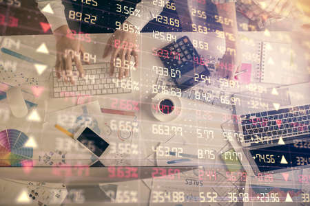 Double exposure of man and woman working together and financial chart hologram drawing. market analysis concept. Computer background. Top View. 免版税图像