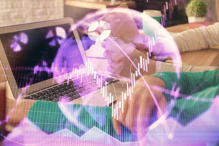Double exposure of man and woman working together and forex chart hologram. Business concept. Computer background.