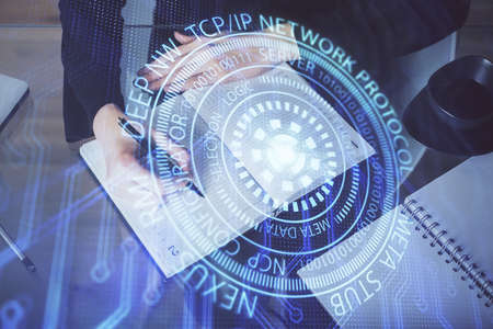 Double exposure of writing hands on background with data solution hologram on front. Technology concept. TOP view. Stockfoto