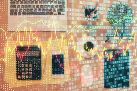 Double exposure of forex chart hologram over desktop with phone. Top view. Mobile trade platform concept.