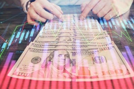 Multi exposure of forex graph drawing hologram and USA dollars bills and man hands. Technical Analysis concept.