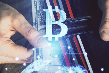 Multi exposure of blockchain theme drawing hologram and USA dollars bills and man hands. Business concept.