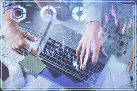 Double exposure of man and woman working together and forex graph hologram drawing. Financial analysis concept. Computer background. Top View.