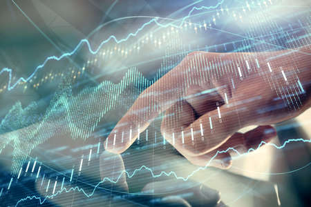 Multi exposure of mans hands holding and using a digital phone and forex graph drawing. Financial market concept.