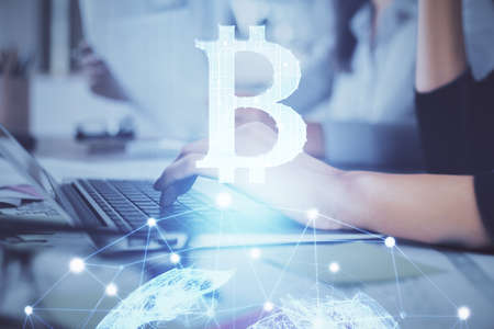 Double exposure of woman hands typing on computer and crypto market theme hologram drawing. Blockchain concept. Фото со стока