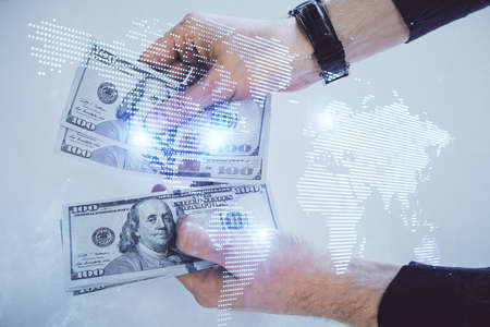 Multi exposure of social network theme drawing hologram and USA dollars bills and man hands.