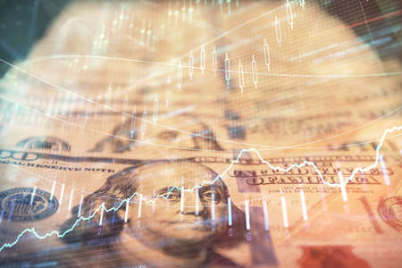 Double exposure of forex graph drawing over us dollars bill background. Concept of financial markets.