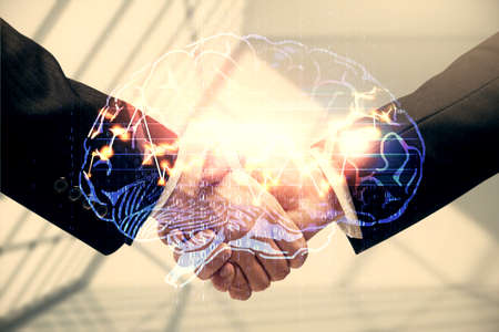 Double exposure of brain hologram and handshake of two men. Partnership in IT industry concept.