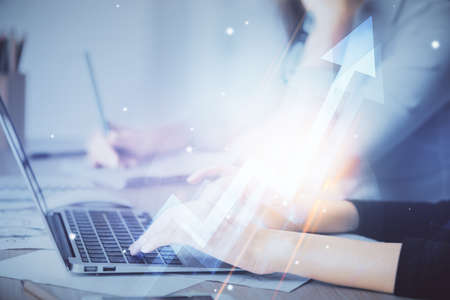 Double exposure of woman hands typing on computer and arrows drawing. Success concept.