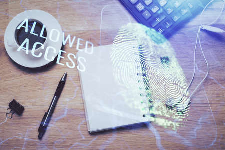 Double exposure of finger print drawing and work table top veiw. Concept of security.