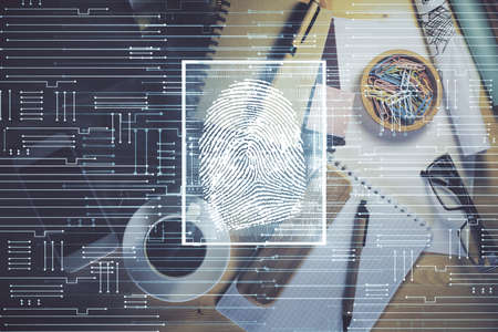 Double exposure of finger print drawing and work table top veiw. Concept of security. Imagens