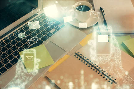 Double exposure of envelope drawing and desktop with coffee and items on table background. Concept of people connection. Imagens