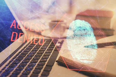 Double exposure of fingerprint drawing and desktop with coffee and items on table background. Concept of security.