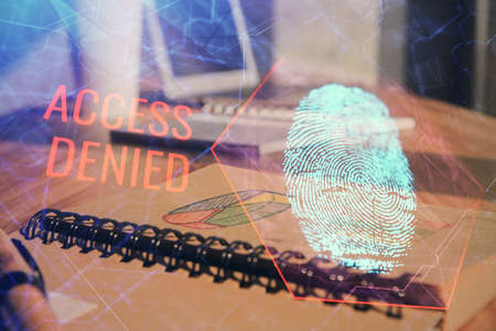 Double exposure of finger print drawing and desk with open notebook background. Concept of security