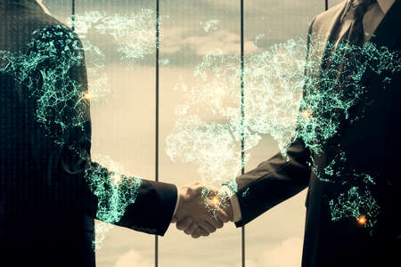 Double exposure of social network theme hologram and handshake of two men.