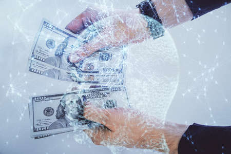 Multi exposure of brain drawing hologram and us dollars bills and man hands. Ai invest concept