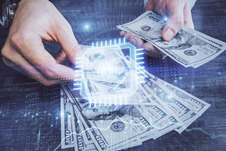 Multi exposure of technology drawing hologram and us dollars bills and man hands. Data concept
