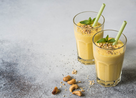 Smoothies of mango, yogurt and cashew in glasses