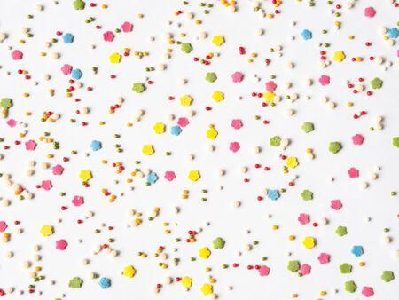 Colored sugar sprinkles background, Sugar sprinkle dots, decoration for cake and bakery, lot of sprinkles background