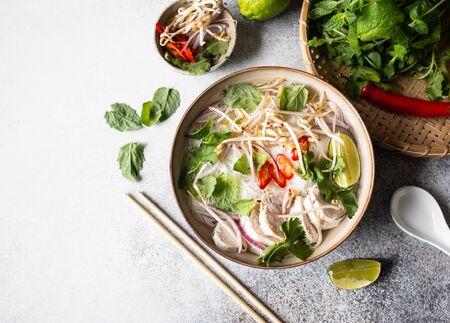 Traditional Vietnamese soup- pho ga in bowl