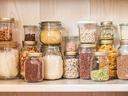 Shelf in the kitchen with various cereals and seeds Foto de archivo