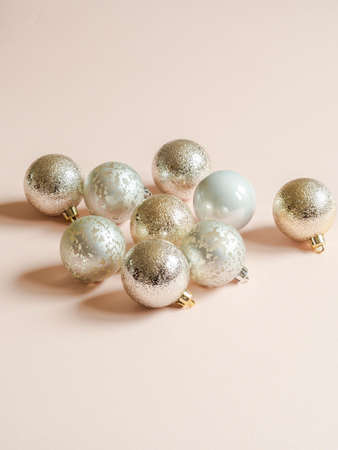 Composition of silver textured christmas balls of on a pastel peach background. Front view. Copy space Stock fotó