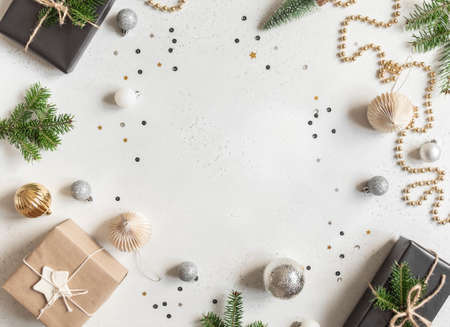 New year or christmas decor frame on light background. Flat lay. Top view. Copy space