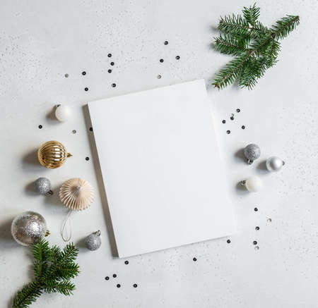 New year or christmas decor and blank white magazine cover mock up on light background. Flat lay. Top view. Copy space Stock fotó
