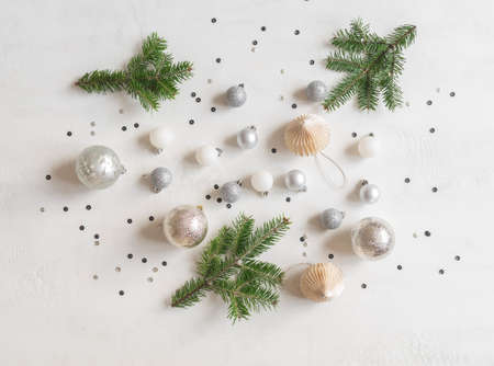 Christmas or new year flat lay confetti and silver christmas balls on white texture background. top view. flat lay