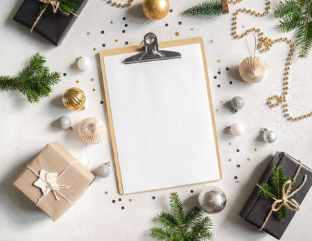 New year or christmas decor and and display a clipboard with a blank sheet of paper mock up on light background. Flat lay. Top view. Copy space Stock fotó - 158900744