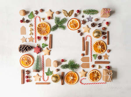 Frame of various items and food related to Christmas on light background. Flat lay. Top view. Copy space