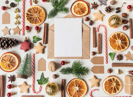 Multicolored Christmas knolling and open envelope with blank postcard for text on light textured background. Flat lay. Top view Stock fotó - 159389905