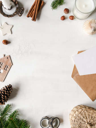 Frame from various vintage and modern Christmas decor on white background. Top view. Copy space