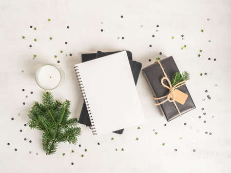 Flat lay of various Christmas decor and notebook with blank page and confetti on white textured background. Top view. Copy space Stock fotó - 159355429