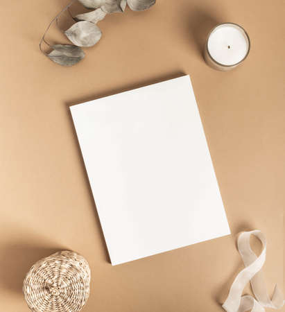 White magazine cover mockup and various decor on beige background. top view. Copy space