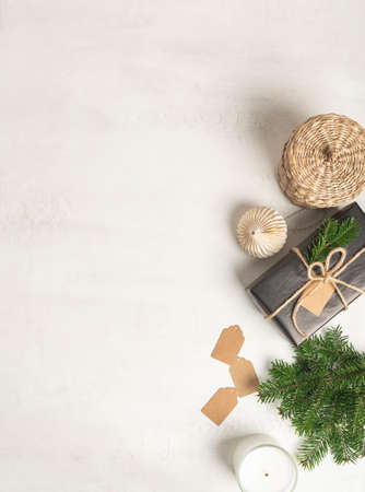 Border of various eco Christmas decor on white textured background. Top view. Copy space