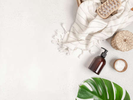 Flat lay of bath accessories and products on light gray background. Top view. copy space Stock fotó