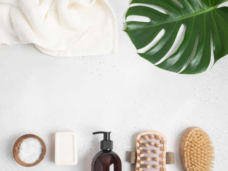 Border of brown bottle mockup for cosmetic products and various bath accessories. top view. copy space. Flat lay. Cosmetics product mock up.