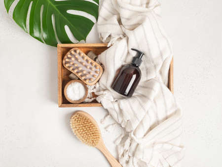Brown bottle mockup for bathing products in the bathroom, spa shampoo, shower gel, liquid soap on cotton towel and various accessories flat lay. Top view. copy space
