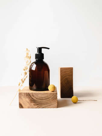 Brown bottle mockup for bathing products on wood podium, spa shampoo, shower gel, liquid soap on white background. Front view. Copy space Stock fotó
