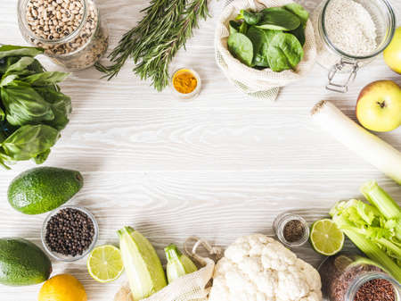 Fresh raw vegetables, fruits, grains and spices on wood light background. Cooking background, copy space. Top view Stock fotó